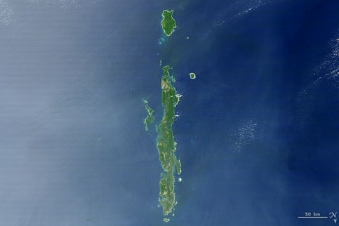Andaman islands. The thin, bright rings surrounding several of the islands are coral reefs that were lifted by an earthquake near Sumatra in 2004