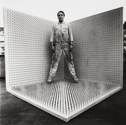 "Günther Uecker in his ""Corner"", Düsseldorf, 1968. Nails on canvas on wood (200 x 200 x 200 cm). Photography by Lothar Wolleh."