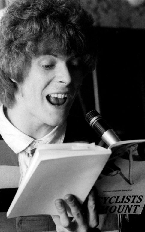 David Bowie at the Beckenham Arts Lab in 1969 reading the 1964 book Bicyclists Dismount by Mason Williams CREDIT: REX FEATURES