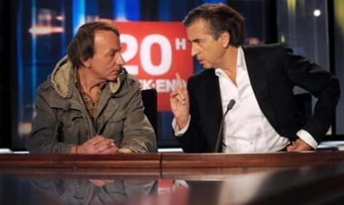 Houellebecq with Bernard-Henri Levy, promoting their book Public Enemies. Photograph: Olivier Laban-Mattei