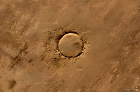 Tenoumer meteorite crater in Mauritania. The meteorite struck Earth between 10,000 and 30,000 years ago