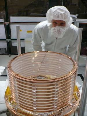 One part of the Enriched Xenon Observatory is held in a clean room during construction. EXO-200 Collaboratio