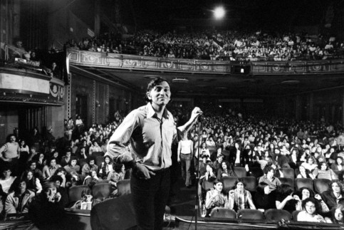 Rock promoter Bill Graham onstage at the Fillmore East. John Olson/Getty