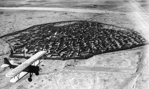 An airplane flies over Baghdad in the early 20th century. Photograph: Getty Images
