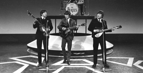 Paul and John, in their matching dark suits, boldly flank George Harrison onstage during a recording session for a Dutch television show in 1964. (Dutch Nationaal Archief, via In Focus)