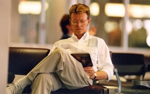 David Bowie in 1995, reading a book about Francis Bacon CREDIT: REX FEATURES