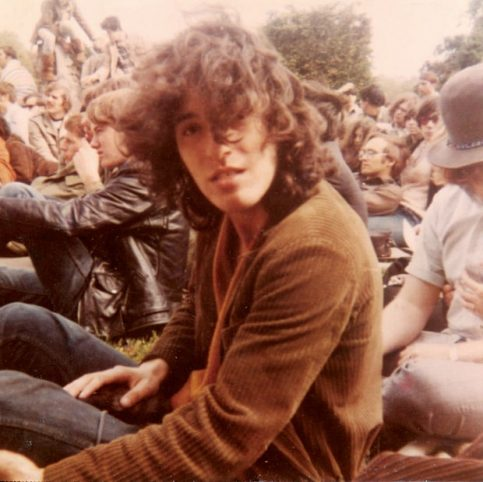Bruce in West Long Brance, N.J., 1969, watching an opening act before performing with his band Child. Billy Smith Collection